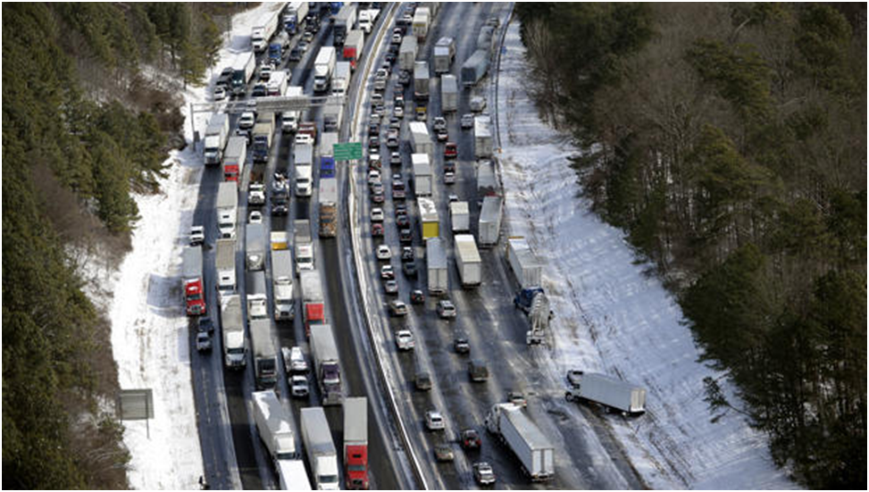 Traffic is snarled along the Interstate 285 perimeter north of the Atlanta metro area after a winter snowstorm Jan. 29, 2014, in this aerial photo. AP PHOTO/DAVID TULIS